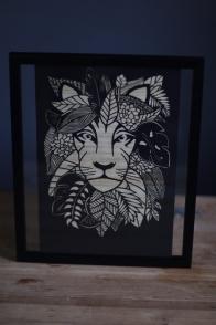 Leafy lion papercut